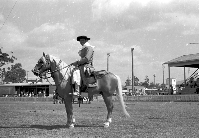 Photo: Action 8 Costumed horserider at the Southport Show, Queensland, September, 1972 [picture] / Bob Avery, photographer. Asset name LS-LSP-CD666-IMG0001