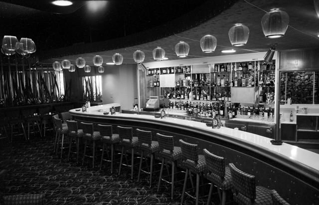 "Photo: Entertainment 5 Interior of the American Bar at the entrance to the Paradise Room in the Surfers Paradise Hotel, Queensland, 1958 [picture] / Alexander McRobbie, photographer. Asset name LS-LSP-CD426-IMG0008 ""This was a glamour venue for pre-dinner cocktails and one of the most popular meeting places in Surfers Paradise. When it opened women, by law, were not allowed to sit at the bar. A protest of women who boldly sat at the bar with their partners was held while the premises was being inspected for licensing approval. Eventually in the 1960s the law was overturned."""