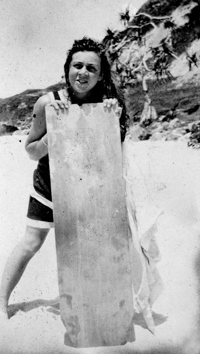 Photo: Beach 19 Unidentified girl with a 'body board' for surfing, Snapper Rocks, Coolangatta, Queensland circa 1920 [picture] / Photographer unknown. Asset name LS-LSP-CD803-IMG0010