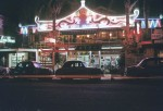 Photo: Hotels 1  Cafe Cathay restaurant at night, Pacific Highway, Surfers Paradise, Queensland, circa 1960. G. A. Black, photographer. LS-LSP-CD1010-IMG005