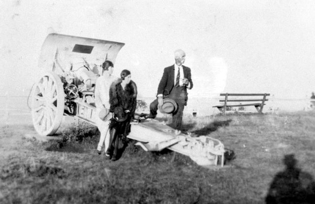Photo: Action 3 Two unidentified women and man on the World War 1 field gun believed to be at Anzac Park, Southport, Queensland, circa 1920 [picture] / Photographer unknown. Asset name LS-LSP-CD129-IMG0018