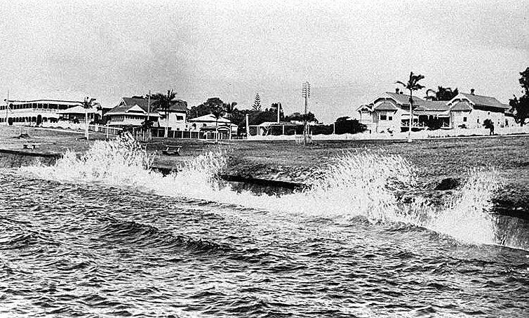 Photo: Beach 21 Waves breaking over the sea wall along the Esplanade near Nerang Street, Southport, Queensland, circa 1920 [picture] / Photographer unknown. Asset name LS-LSP-CD092-IMG0015