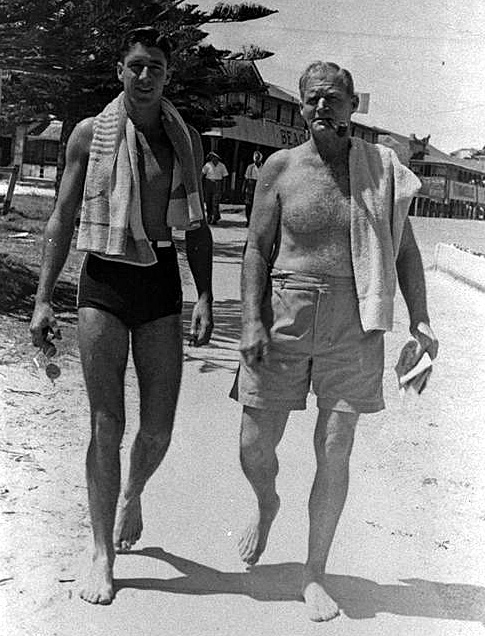 Photo: Beach 5 Jack Gordon, on the right with son Barry, Coolangatta, Queensland, 24 November, 1946 [picture] / Photographer unknown. Asset name LS-LSP-CD095-IMG0062