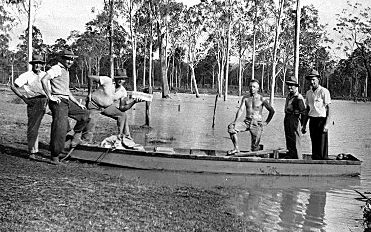 Photo: Events 8 Delivering bread via a boat which was rowed through flood waters to stranded homes, Waterford, 1947. [picture] Asset name LS-LSP-CD098-IMG0069