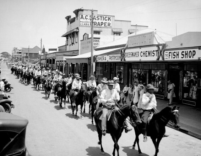 Photo: Events 2 Large numbers of horses and riders riding east along Nerang Street, Southport, Queensland, circa 1930s [picture] / George A. Jackman, photographer. Asset name LS-LSP-CD327-IMG0001