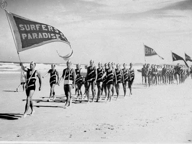 Photo: Beach 1 Surfers Paradise Surf Life Saving Club leading the march past at a surf carnival in 1947, Queensland. Photographer unknown.  LS-LSP-CD131-IMG0021