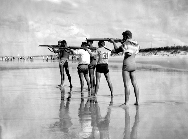 Photo: Action 4 Believed to be lifesavers shooting rifles at sharks to protect swimmers at Main Beach, Southport, Queensland, circa 1930s. George A. Jackman, photographer. LS-LSP-CD324-IMG0012