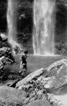 Kay Gibbs captures a ghost. View of the swimming hole at the base of Twin Falls, Springbrook, circa 1940s [picture] / Graham Hardy, photographer. Asset name LS-LSP-CD292-IMG0007