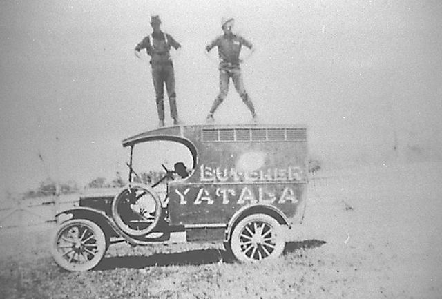 Photo: Work 2 Gustav Haack's meat delivery van with two men standing on the roof of the 1923 Model T Ford, Queensland, circa 1920s [picture] / Photographer unknown. Asset name LS-LSP-CD066-IMG0099