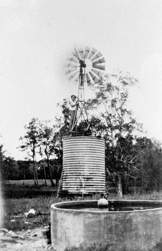Photo: Structures 11 Windmill and cement water trough on Goodings farm, Benowa, Queensland, 1924 [picture] / Photographer unknown. Asset name LS-LSP-CD788-IMG0011