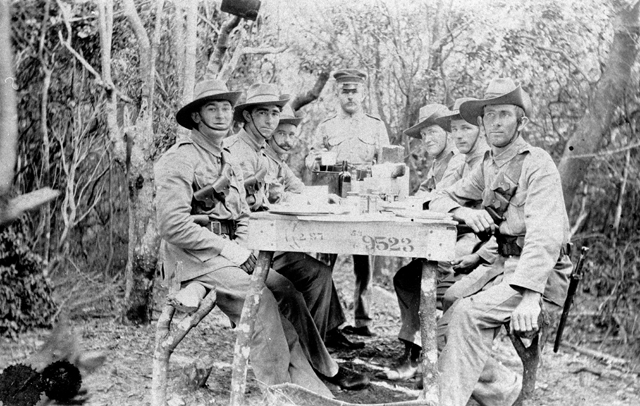 Photo: Entertainment 10 Believed to be Cable Station Guards having tea, Southport, Queensland, circa 1914 [picture] / Photographer unknown. Asset name LS-LSP-CD777-IMG0007
