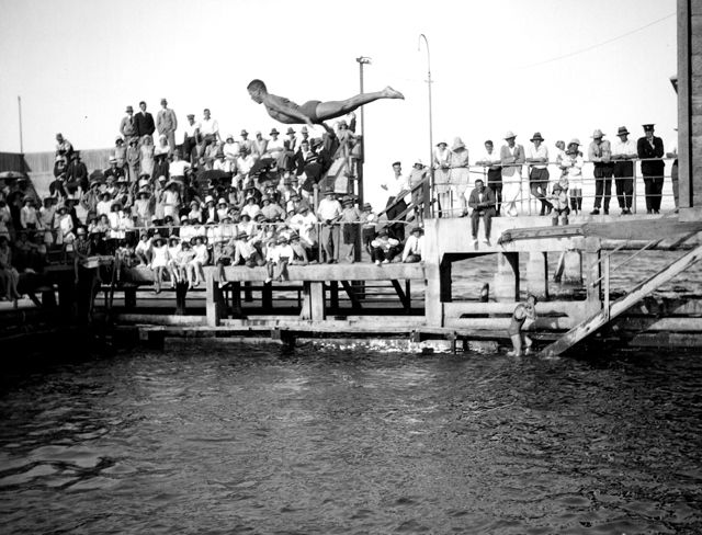 Photo: Action 2 Unidentified male diving into the swimming pool attached to the Southport Pier, Southport, Queensland, circa 1930s. George A. Jackman, photographer. LS-LSP-CD335-IMG0002