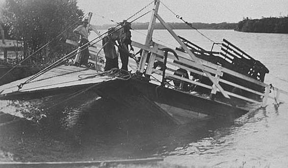Photo: Action 12 Salvaging Mick Gardiner's produce truck from the sinking Alberton Ferry, Queensland, circa 1940s [picture] / Photographer unknown. Asset name LS-LSP-CD030-IMG0030