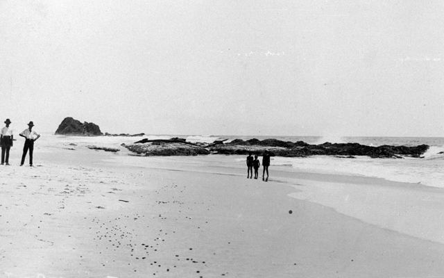 Photo: Beach 17 Tugun Beach with unidentified men and three children looking past Flat Rock towards Elephant Rock, Tugun, Queensland, circa 1920s [picture] / Photographer unknown. Asset name LS-LSP-CD137-IMG0029