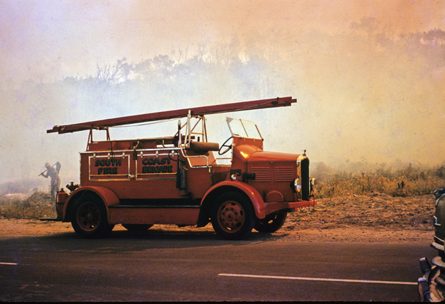 Photo: Work 9 A Dennis fire engine from the South Coast Fire Brigade, at a bushfire in Palm Beach, Queensland, circa 1959 [picture] / G. A. Black, photographer. Asset name LS-LSP-CD1009-IMG001