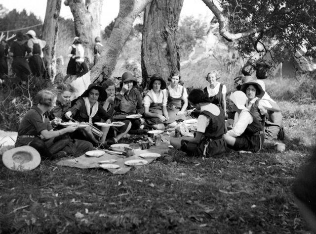 Photo: Events 5 Girl Guides eating a meal prepared while on camp on the South Coast, Queensland, circa 1930s [picture] / George A. Jackman, photographer. Asset name LS-LSP-CD331-IMG0007